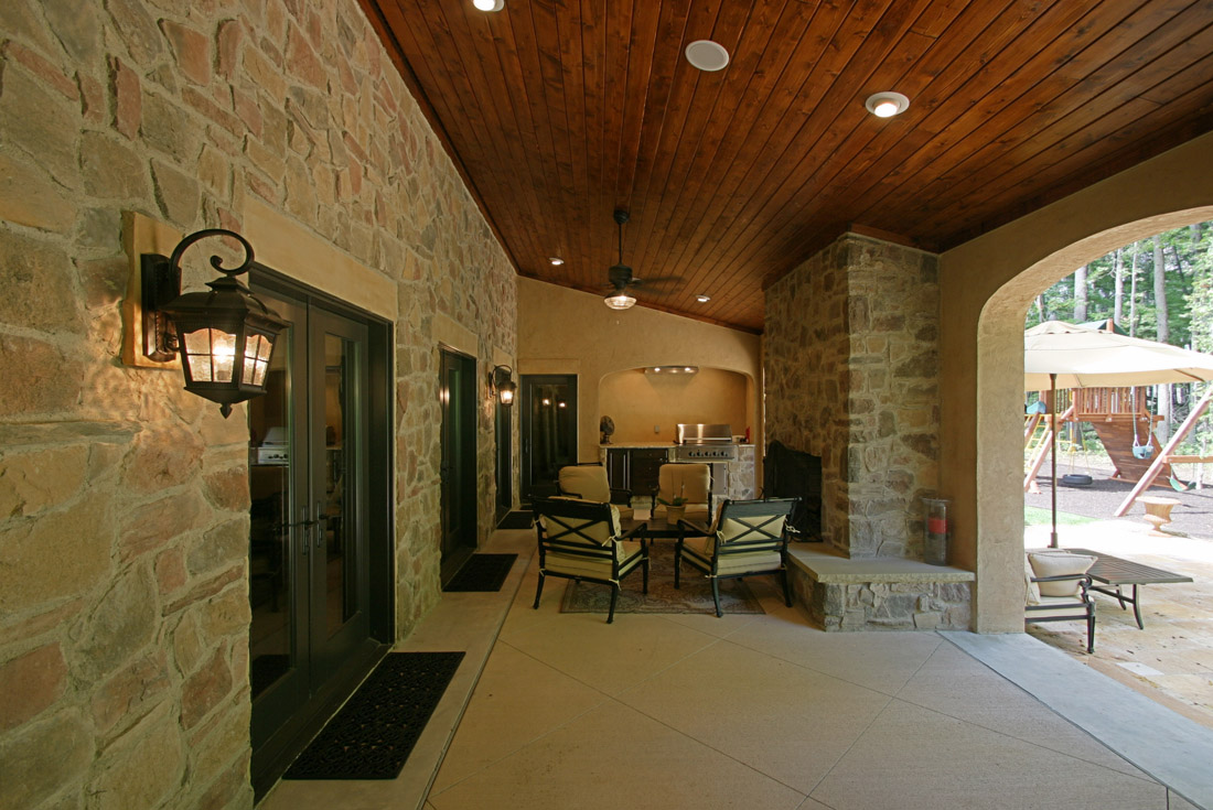 tuscan custom home covered porch